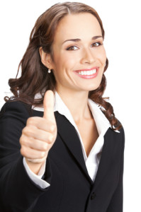 Businesswoman with thumbs up, on white